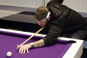 Playing pool whilst wearing a biometric monitor.