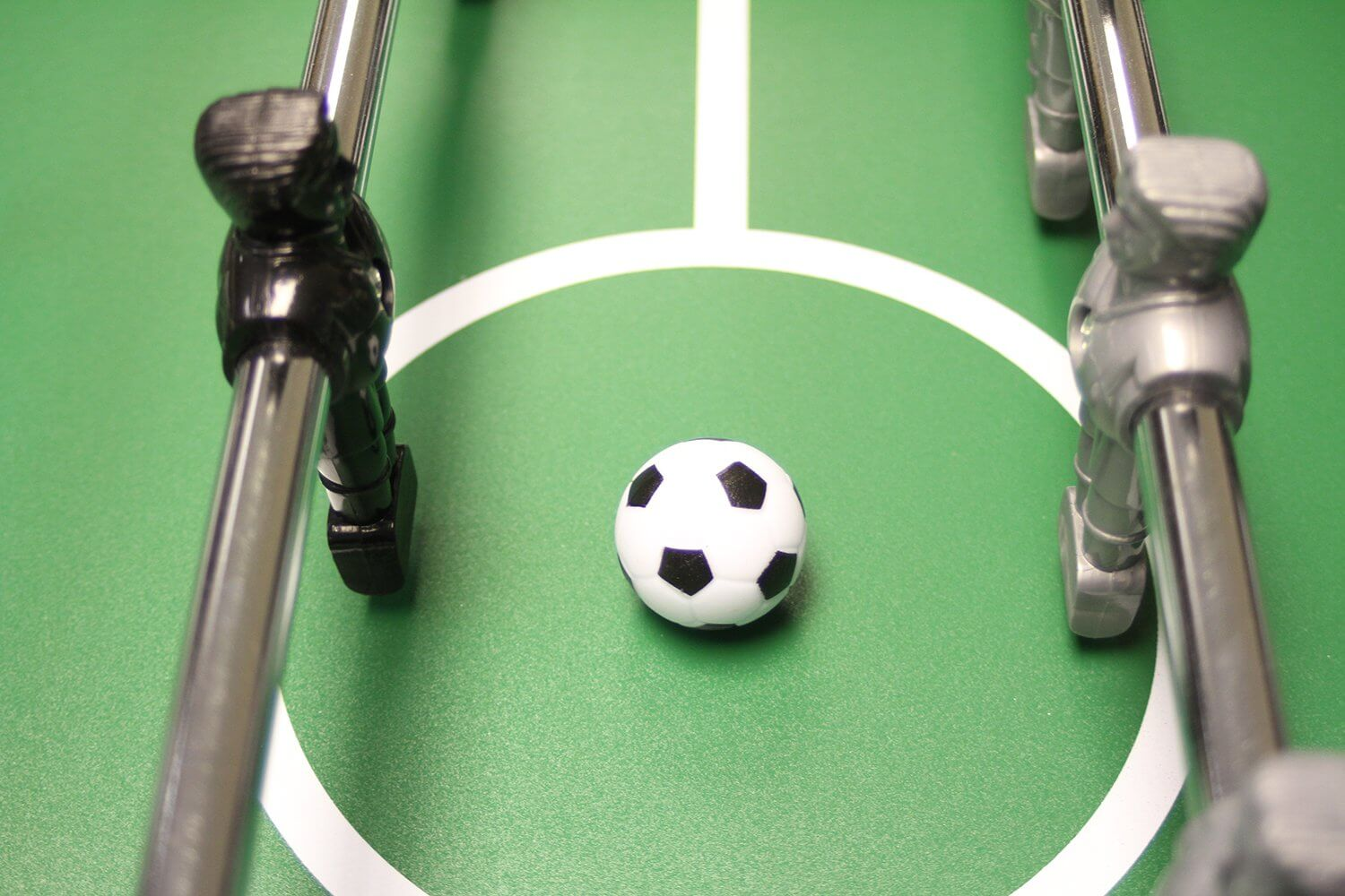 A plastic foosball on the pitch