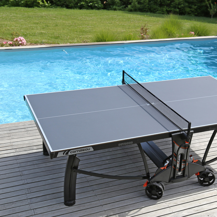 A 700M table tennis by a swimming pool