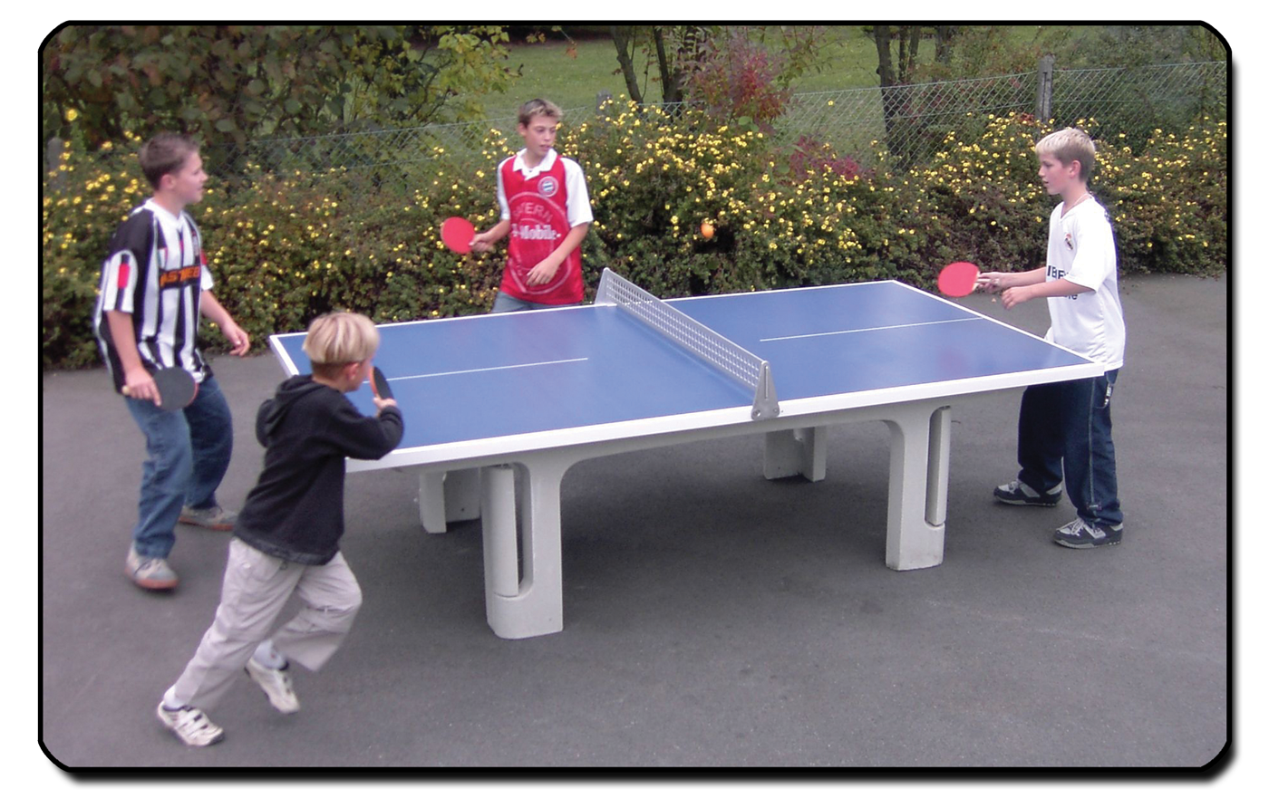 Butterfly Park Concrete table tennis table in use