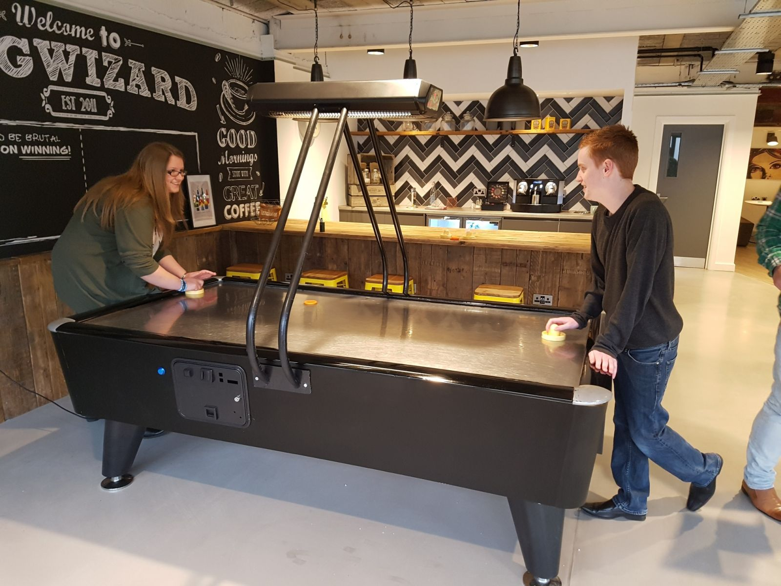 Black reconditioned Fast Track air hockey table