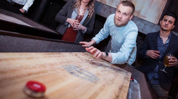 Players having a game of shuffleboard