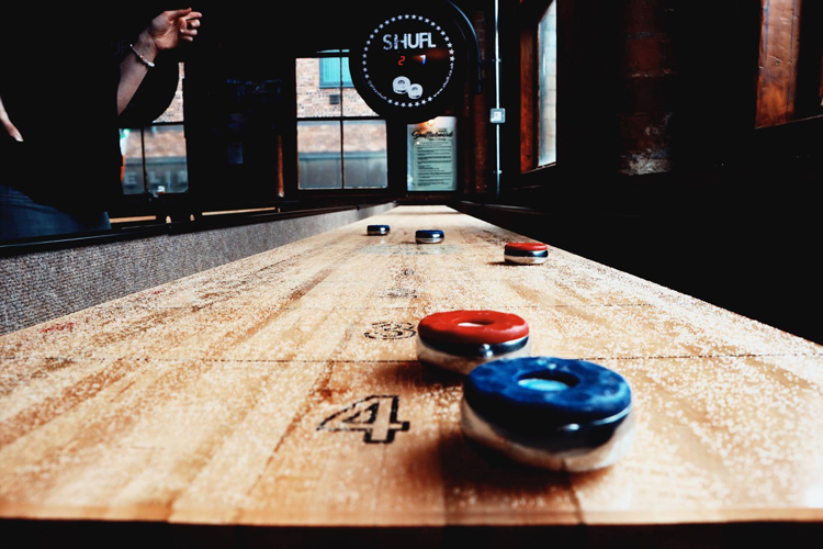 The playfield on a shuffleboard table