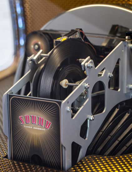 Detail of the play mechanism on the Vinyl Rocket jukebox