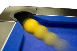 A ball going into a pocket on the Supreme Slimline pool table