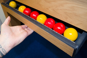 The Classic Doner pool table has a ball drawer