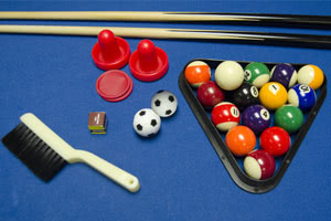 Free pool table accessories supplied with the Trisport