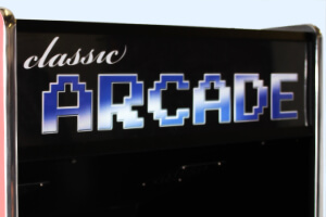 The illuminated arcade sign on the Cosmic arcade.
