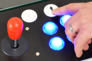The coffee table arcade machine's 1p button.
