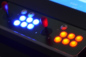 The coffee table arcade machine illuminated buttons.