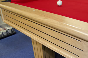 The Rincao pool table is ornately carved