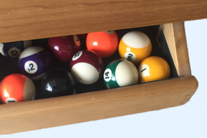 The Precision pool dining table's ball drawer