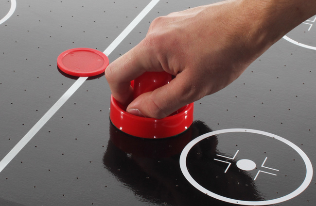 The Tekscore 65mm air hockey puck in play