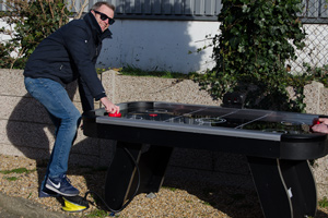 A foot pump air hockey table outdoors