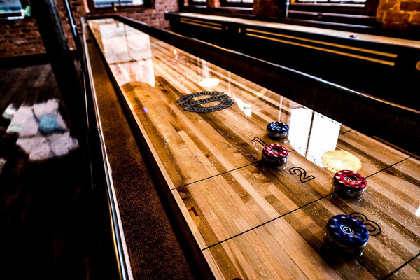 Shuffleboard tables in a trendy bar