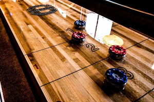 The play field on a Champion shuffleboard table