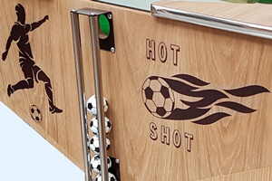 The ball chute on the Hot Shots game