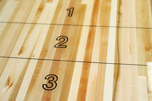 The scoring zone of a shuffleboard table