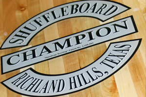 The Champion shuffleboard logo