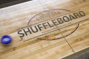 A freshly-cleaned shuffleboard playfield