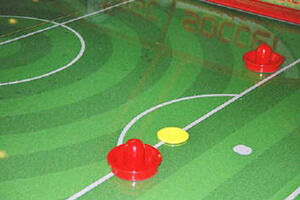The playfield on the Fast Soccer air hockey table