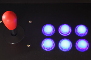 The illuminated fire buttons on the Cosmic arcade.