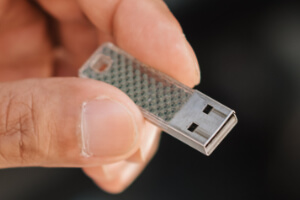 A USB stick used for loading games onto an AtGames Gamer Mini.