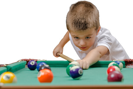 A young pool player with a 36-inch cue.