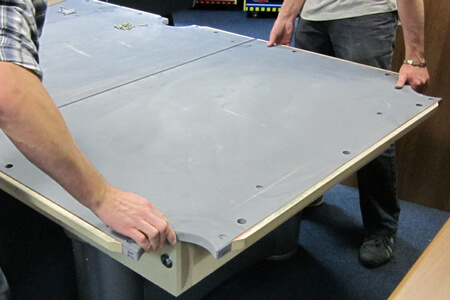 A slate bed being fitted to a pool table.