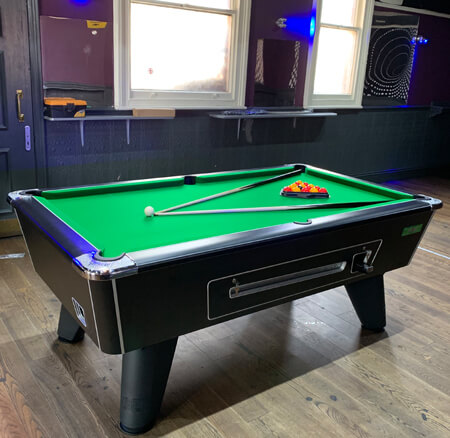 A coin-operated Supreme Winner pool table.