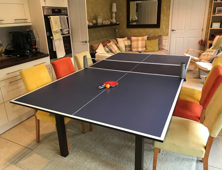 A Tekscore table tennis top on a pool table.