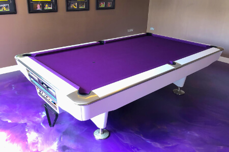 An LA Pro pool table installed on a laminate floor.