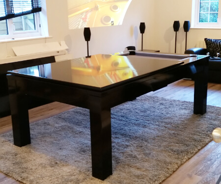 A Phoenix pool dining table on an area rug.