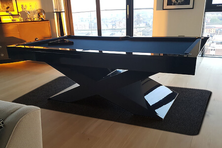 An Xtreme pool table installed on a mat.