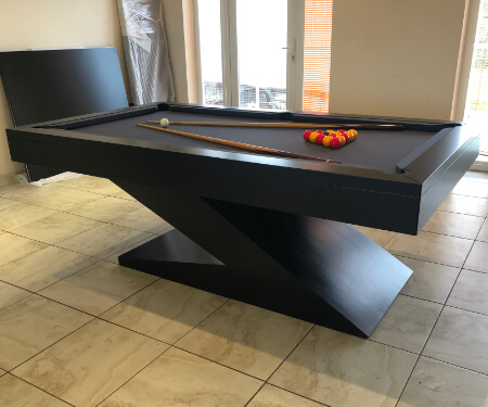 A Zen pool table installed on a tiled floor.