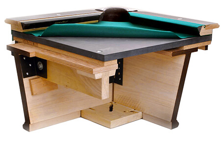 A pool table cutaway showing the slate bed.